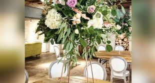 Metal Riser with Large floral arrangement including Orchids and Eucalyptus