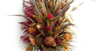 Six feet tall dried floral arrangement with pheasant feathers. By Arcadia Floral...